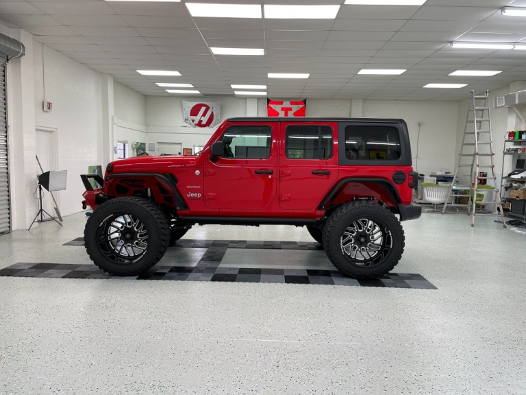 Used 2019 Jeep Wrangler Unlimited Sahara Sport Utility 4D for sale Sold at Track & Field Motors in Safety Harbor FL 34695 4