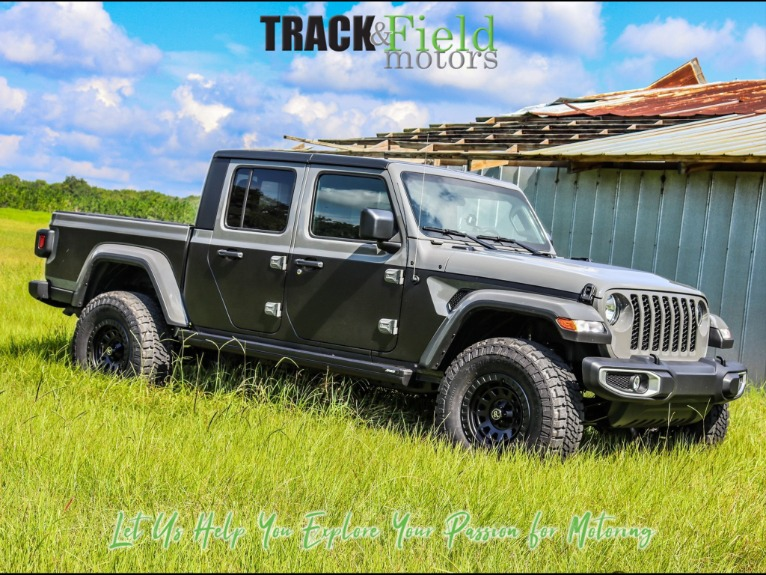 Used 2021 Jeep Gladiator Sport Pickup 4D 5 ft for sale $64,497 at Track & Field Motors in Safety Harbor FL 34695 1