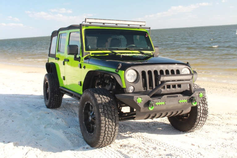 Used 2014 Jeep Wrangler Unlimited Sport SUV 4D for sale Sold at Track and Field Motors in Safety Harbor FL 34695 2
