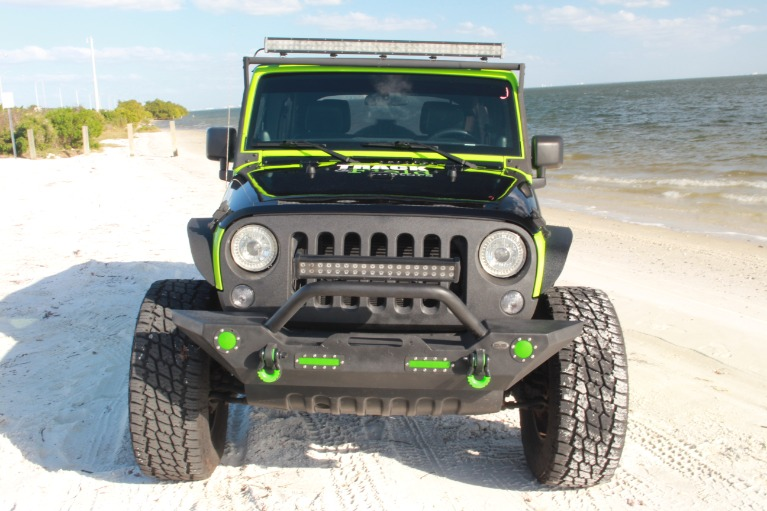 Used 2014 Jeep Wrangler Unlimited Sport SUV 4D for sale Sold at Track and Field Motors in Safety Harbor FL 34695 3