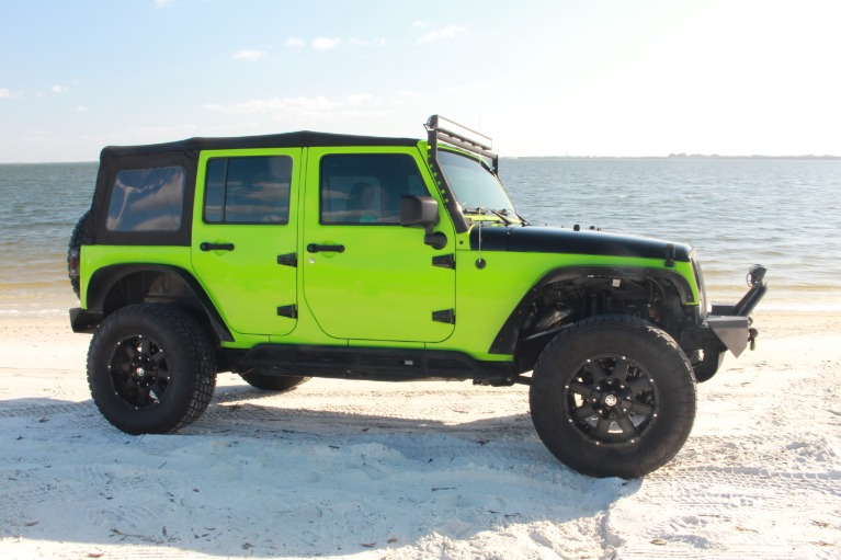 Used 2014 Jeep Wrangler Unlimited Sport SUV 4D for sale Sold at Track and Field Motors in Safety Harbor FL 34695 4