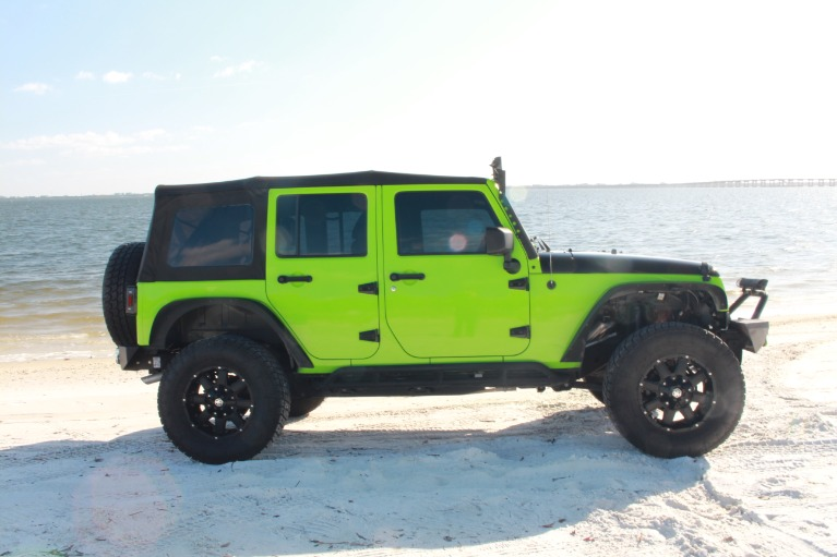 New 2014 Jeep Wrangler Unlimited Sport SUV 4D for sale $27,997 at Track and Field Motors in Safety Harbor FL 34695 5