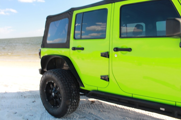 Used 2014 Jeep Wrangler Unlimited Sport SUV 4D for sale Sold at Track and Field Motors in Safety Harbor FL 34695 6