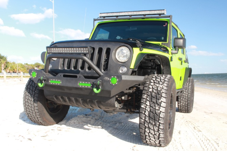 Used 2014 Jeep Wrangler Unlimited Sport SUV 4D for sale Sold at Track and Field Motors in Safety Harbor FL 34695 7