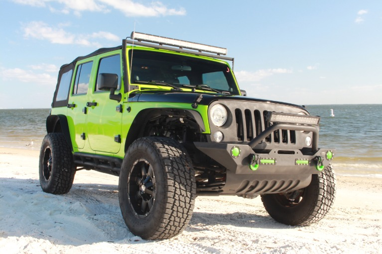 New 2014 Jeep Wrangler Unlimited Sport SUV 4D for sale $27,997 at Track and Field Motors in Safety Harbor FL 34695 1