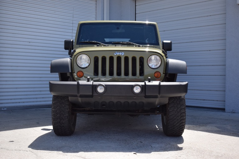 Used 2013 Jeep Wrangler Unlimited Sport SUV 4D for sale Sold at Track and Field Motors in Safety Harbor FL 34695 3