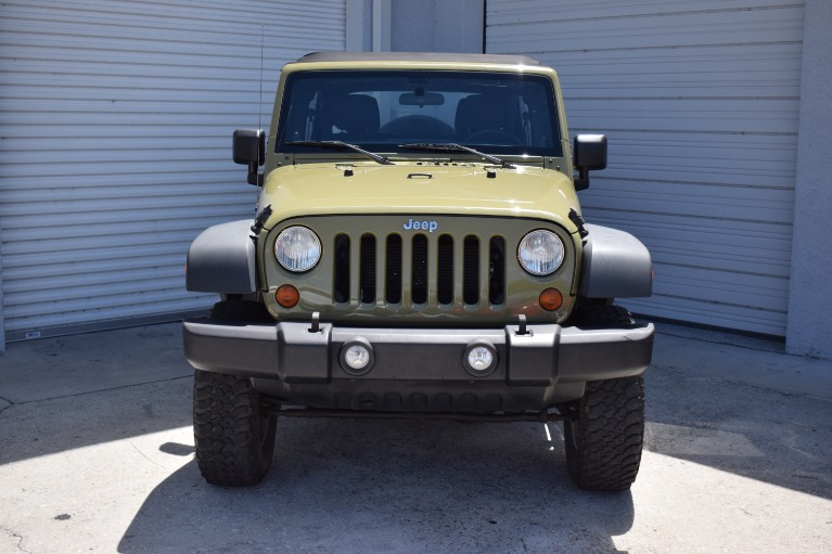 Used 2013 Jeep Wrangler Unlimited Sport SUV 4D for sale Sold at Track and Field Motors in Safety Harbor FL 34695 4