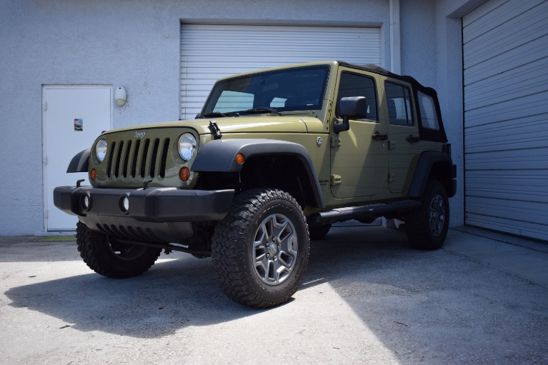 Used 2013 Jeep Wrangler Unlimited Sport SUV 4D for sale Sold at Track and Field Motors in Safety Harbor FL 34695 5