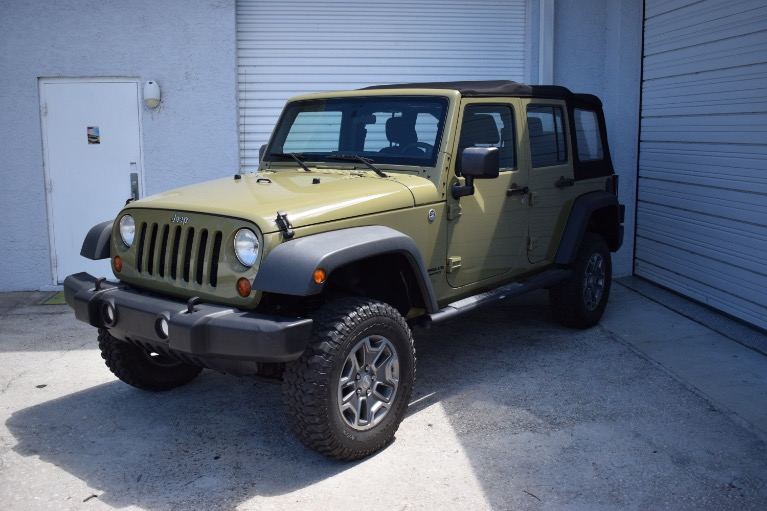 Used 2013 Jeep Wrangler Unlimited Sport SUV 4D for sale Sold at Track and Field Motors in Safety Harbor FL 34695 6