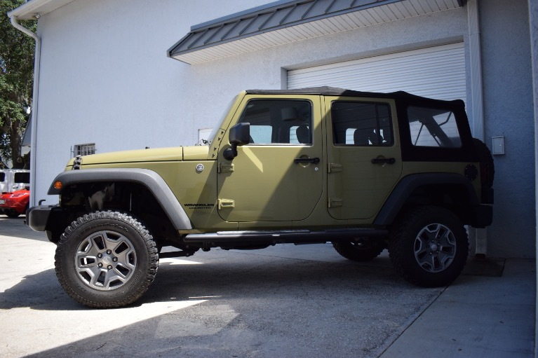 Used 2013 Jeep Wrangler Unlimited Sport SUV 4D for sale Sold at Track and Field Motors in Safety Harbor FL 34695 7
