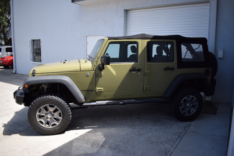 Used 2013 Jeep Wrangler Unlimited Sport SUV 4D for sale Sold at Track and Field Motors in Safety Harbor FL 34695 8