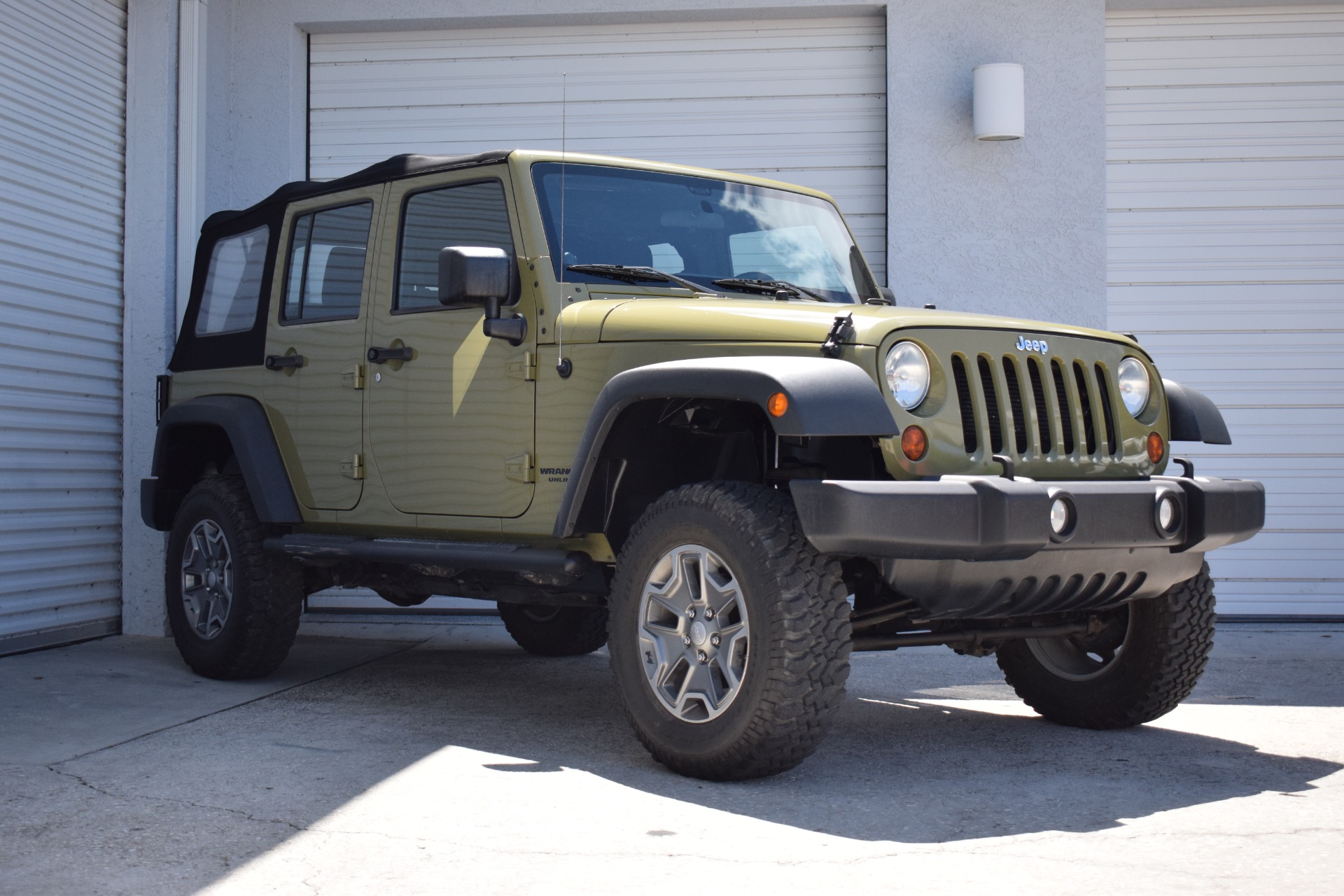 Used 2013 Jeep Wrangler Unlimited Sport SUV 4D for sale $14,997 at Track and Field Motors in Safety Harbor FL